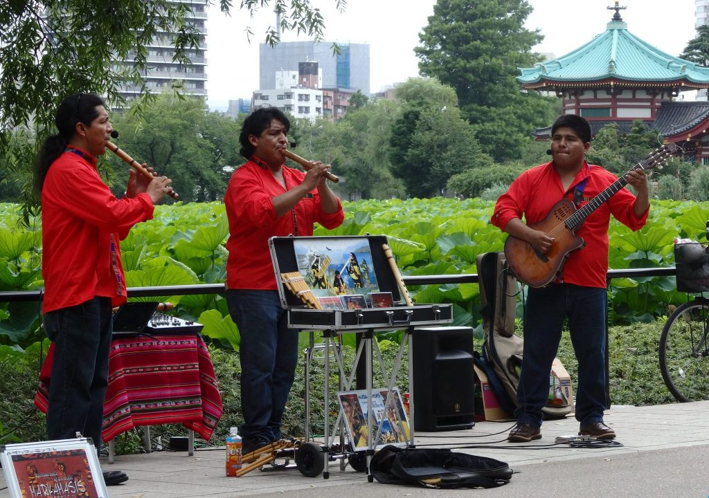 three South American musicians performing in Ueno Park in Tokyo