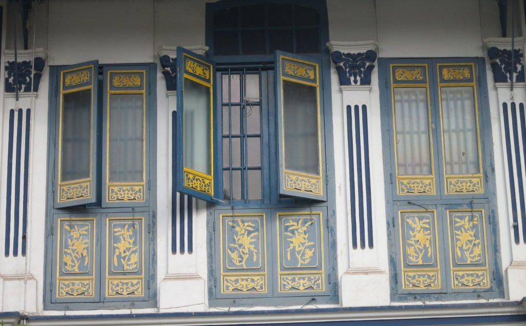 Upper-floor shutters on a house in Emerald Hill in Singapore would have allowed the breezes in in the days before air conditioning.