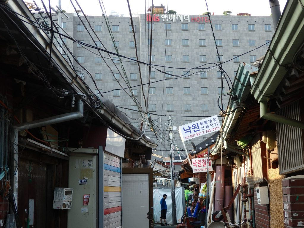 In the background, the Ibis Hotel looms over the Ikseon Hanok Area houses in the foreground.
