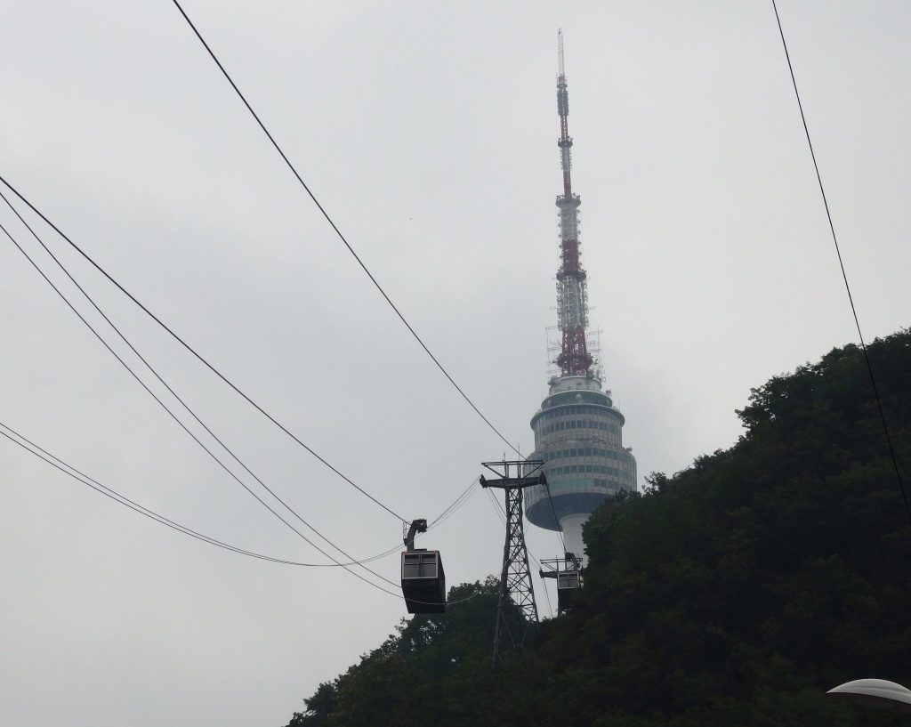 the cable car with Seoul Tower in the background