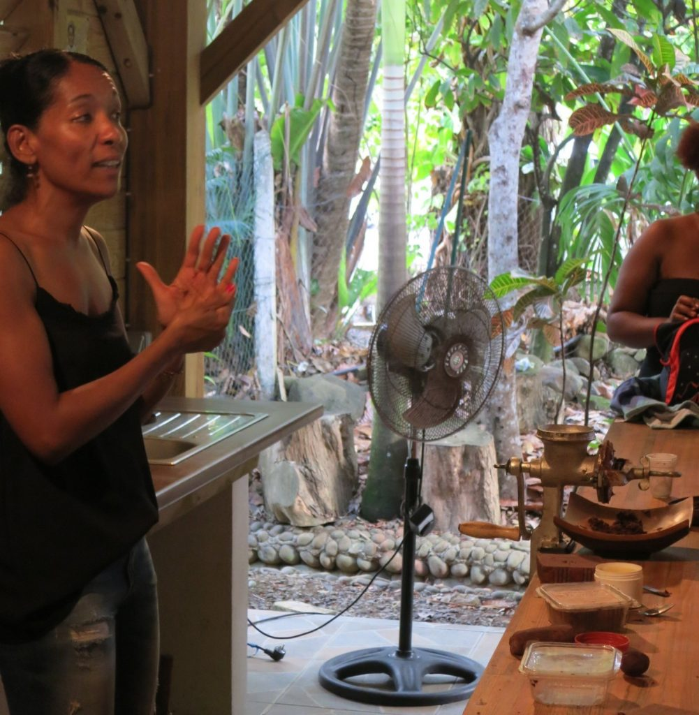 A staff member explains the chocolate-making process.