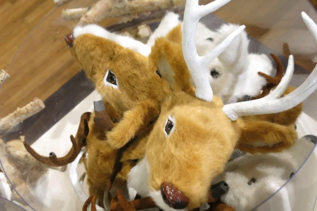 creepy stuffed reindeer heads to hang on the wall for Christmas