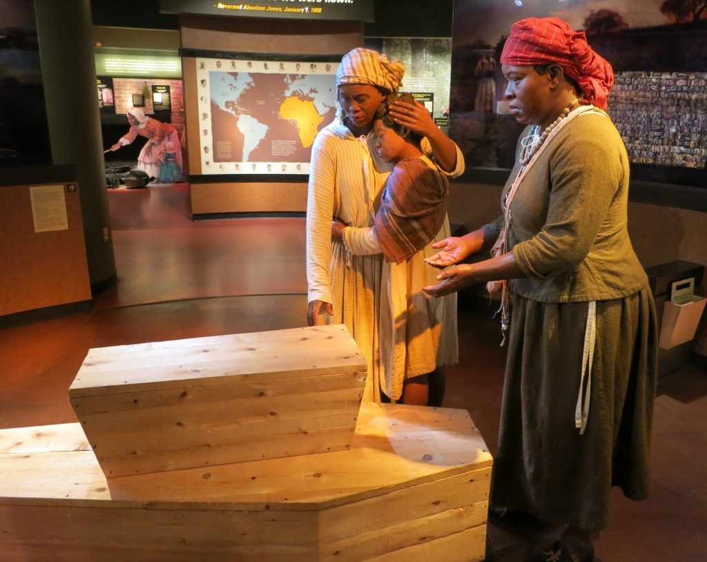 This life-size display greets visitors as they enter the museum: a representation of a funeral at the African Burial Ground.