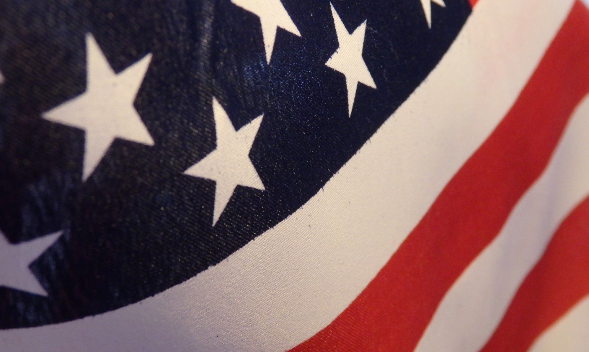 close-up of the American flag, representing the American Dream