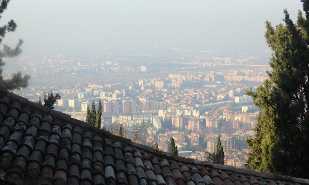 A view of the city from near the top. That roof in the foreground is the San Luca arcade itself.