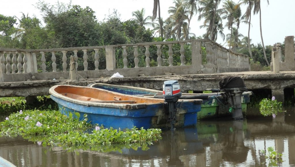 boats moored at the crumbling dock on the island off Badagry, Nigeria