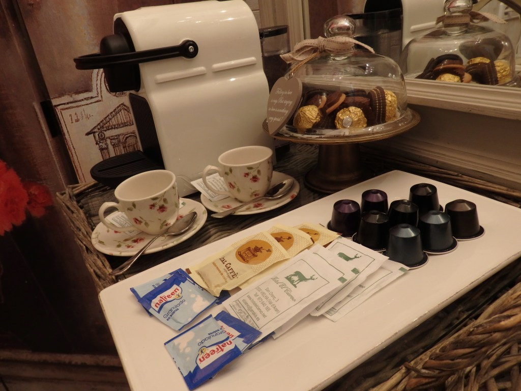 the coffee machine and sweets that welcomed us to our room at Hotel El Ciervo