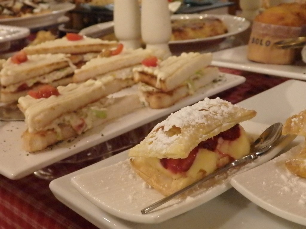 a fruit-filled pastry, in front of a sandwich of some sort, with more baked goods in the background, at Hotel El Ciervo