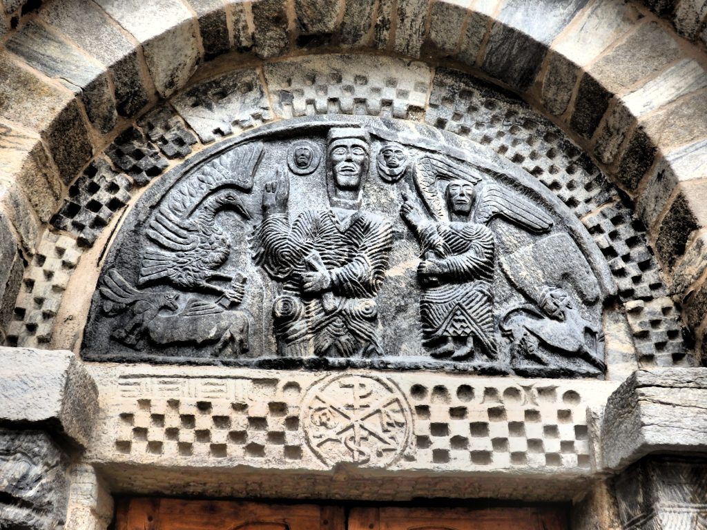 A more sophisticated medieval carving above a doorway on the church of Santa Maria in Bossòst in the Val d'Aran, Spain.