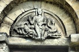 carving above the door of Sant Felix in Vilac, Val d'Aran, Spain