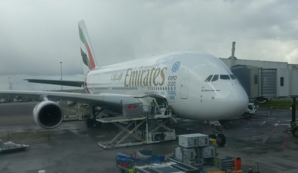 The Emirates A380 at Schiphol Airport, parked at the gate being loaded with cargo.