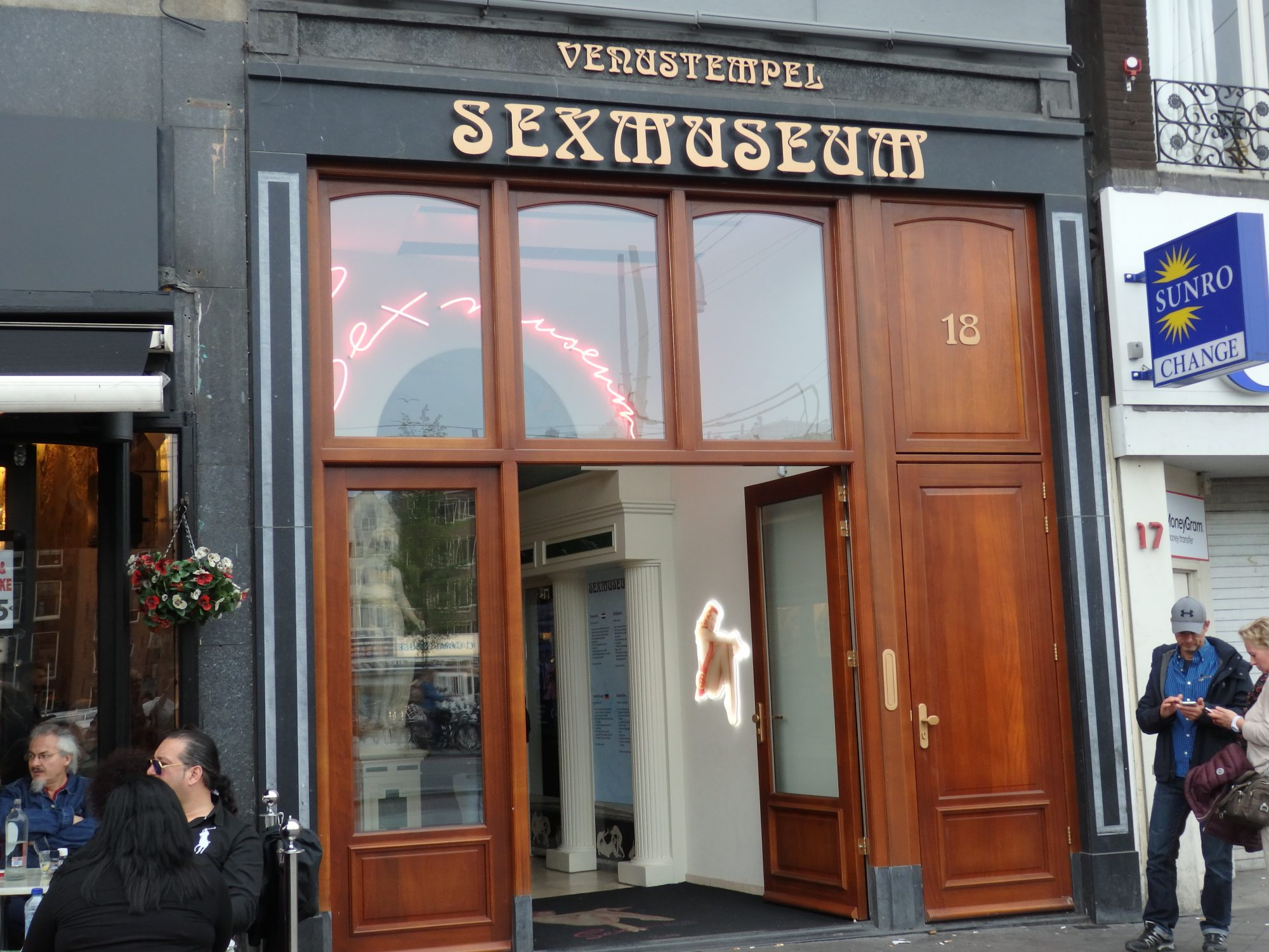 The Sex Museum's entrance is a storefront on busy Damrak.