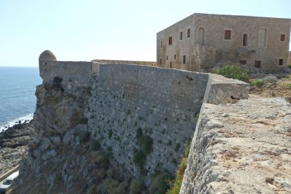 This view gives an idea of how the Rethymnon fortress walls tower above the sea. The building is the House of the Councillors.