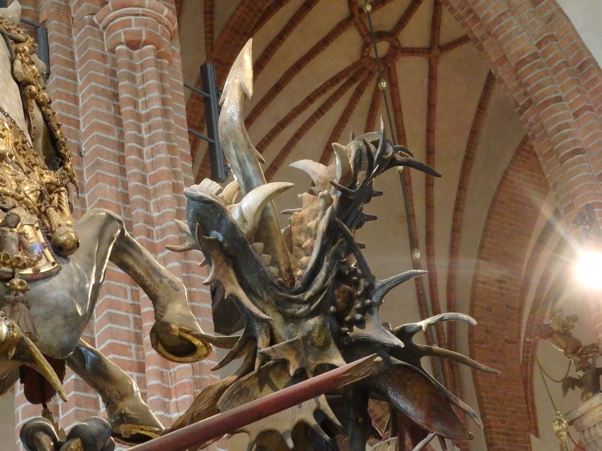 a detail of the statue of St George in Storkyrkan showing the dragon's head: Stockholm, Sweden