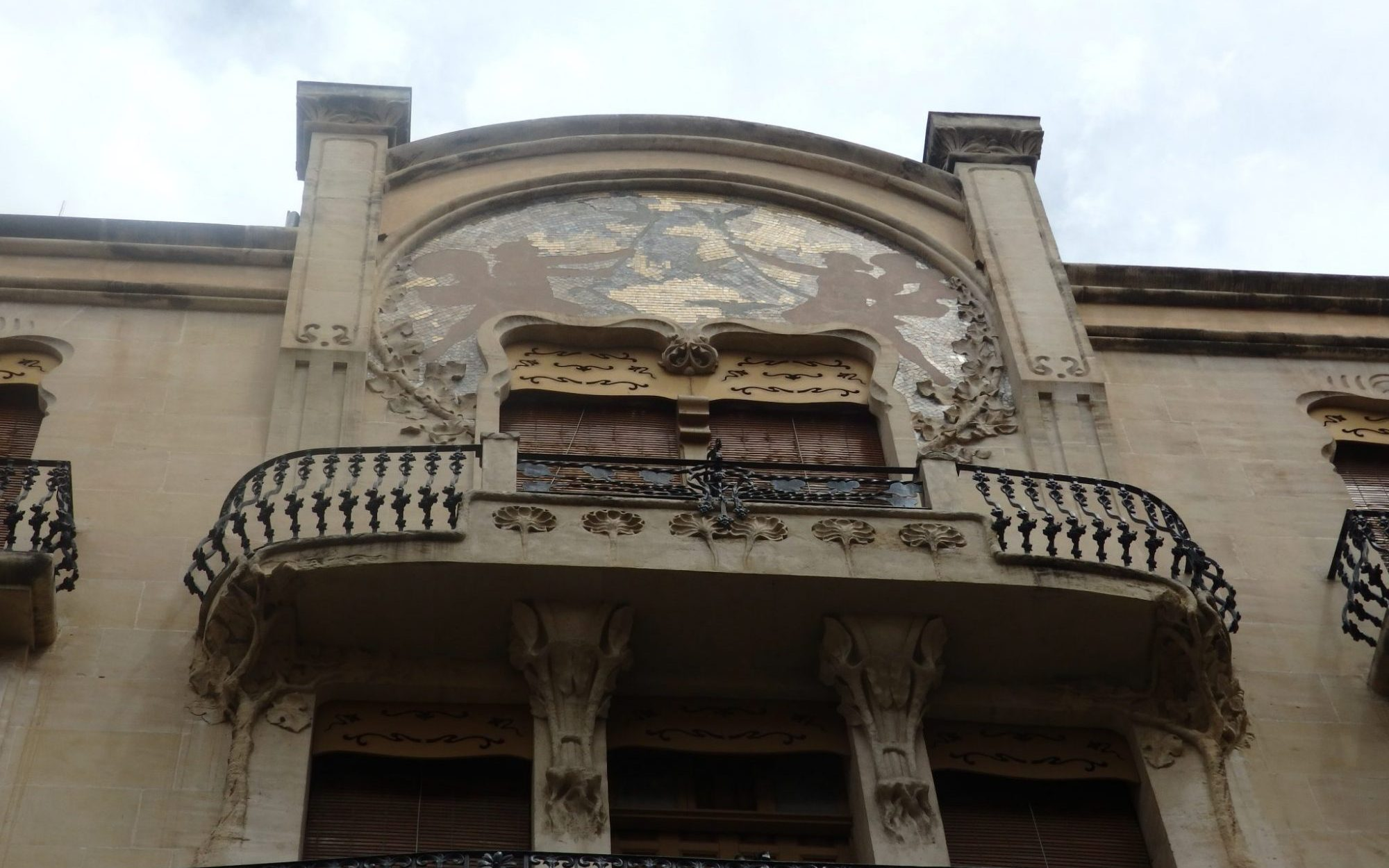 You can see a similarity to Art Nouveau and Jugendstil in the artwork on the facade of this building.