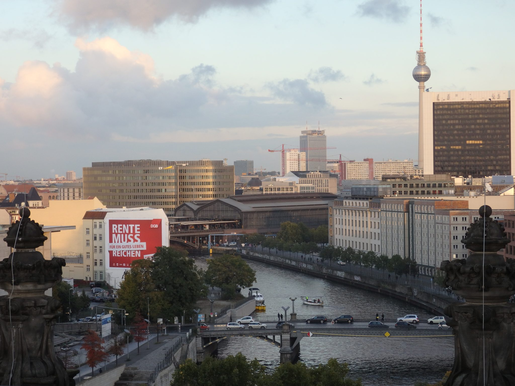 One of many views from the Reichstag dome. Here, on the Spree River, you can see Friedrichstrasse Station, the low brown building; the Television Tower; and, in front of the tower, the International Trade Center.