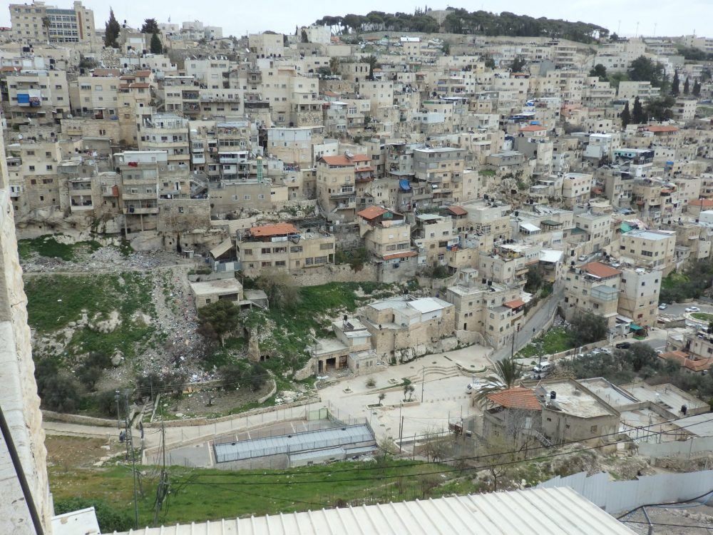Visiting the City of David: In this view from the viewpoint, you can see the valley far below and the buildings of an Arab neighborhood across the way.