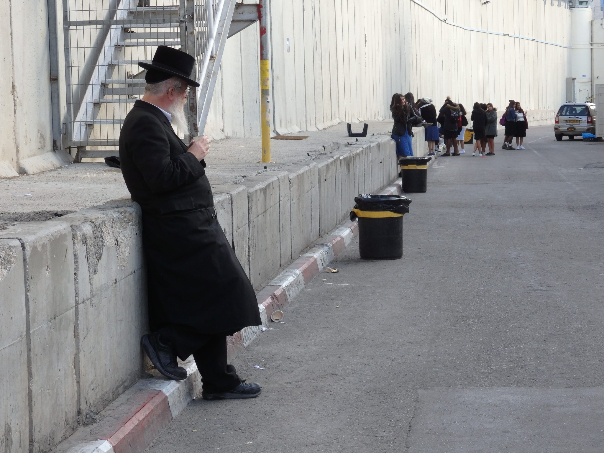 An Orthodox Jew takes a break outside Rachels Tomb