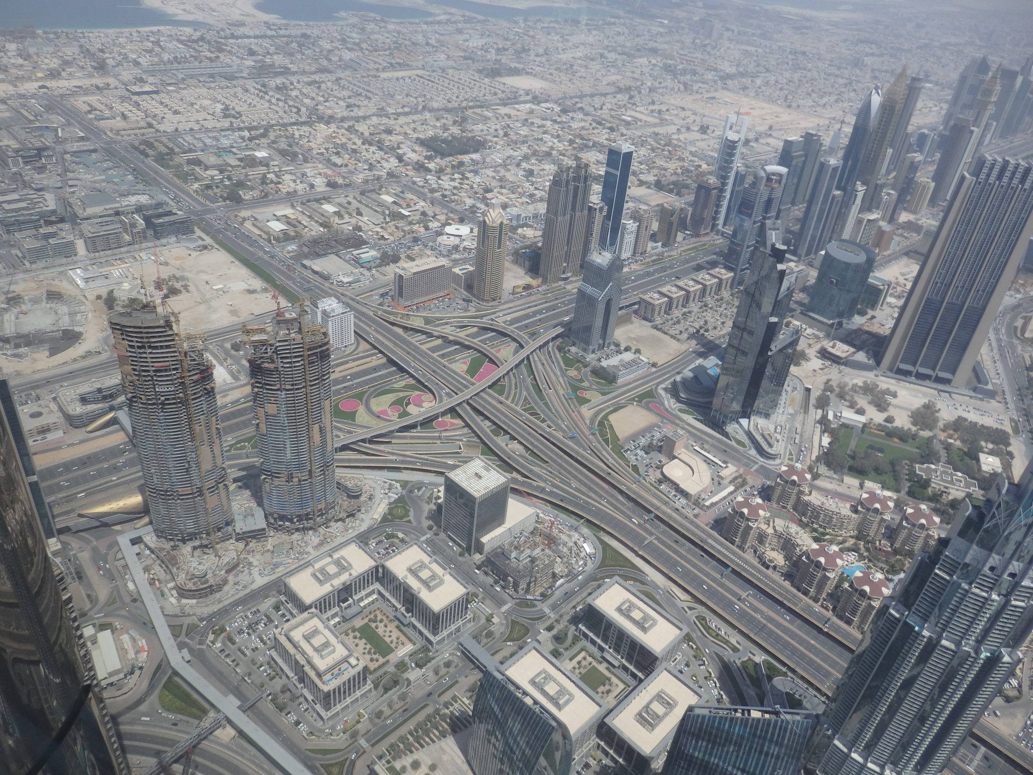 If you look on the left side of this picture, beyond the two towers under construction, you'll see a patch of vacant land, a common sight all over Dubai. Around the highway junction, you can see the carefully-tended greenery that must take an enormous amount of water. Visiting Burj Khalifa