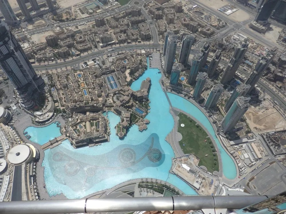 Looking straight down from the 148th floor of Burj Khalifa. The low building at the bottom left is a small part of the very large Dubai Mall.