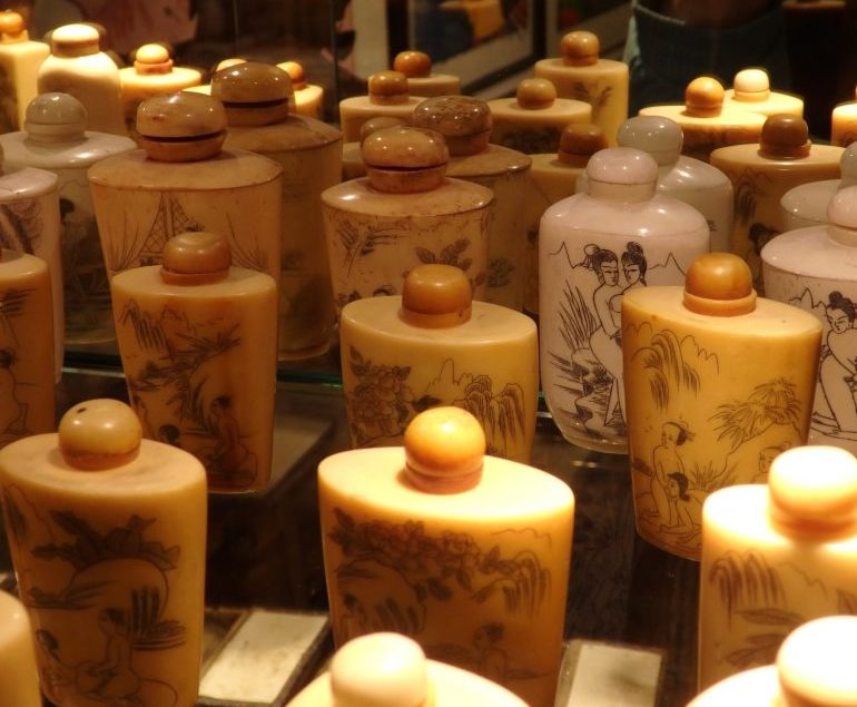 bottles made in France with images of Asians in the Erotic Museum Amsterdam