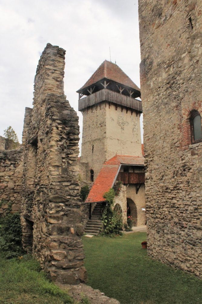 In this picture of Calnic fortified church, you can see a piece of a ruined interior wall, one of the exterior wall towers, and, to the right, the keep. Photo courtesy of Albert Smith.