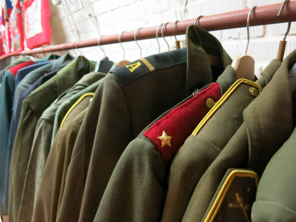 A rack of Cold War-era uniforms inside the shelter. Macabre sightseeing in Brno