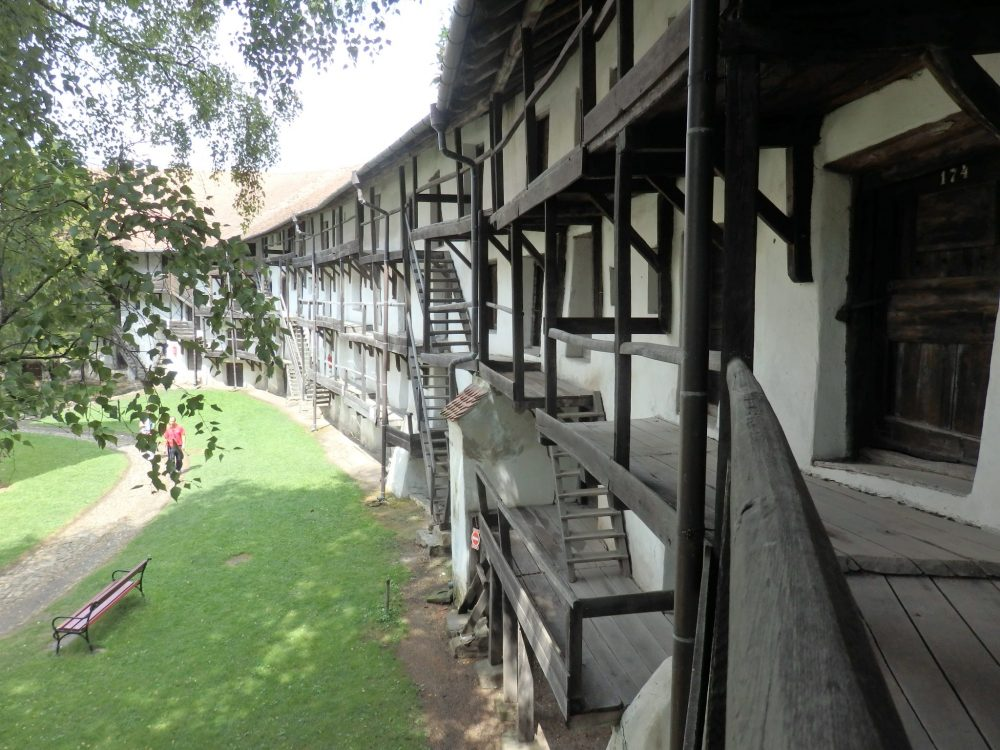 A view of some of the exterior walkways and rooms inside the defensive wall of Prejmer fortified church.