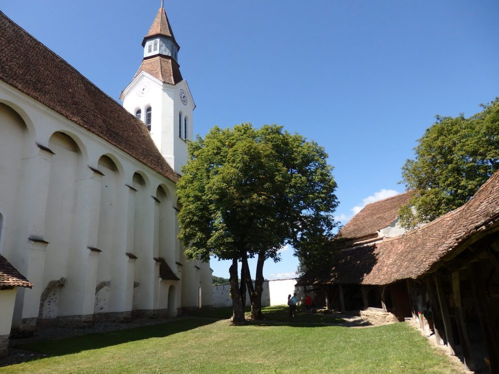 Bunesti church on the left, with fortifications on the right.