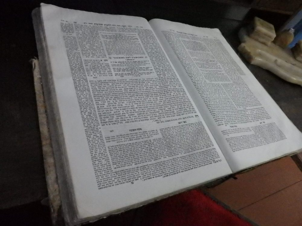 A talmud lies open on the desk at the Elie Wiesel Memorial House. I cant read Hebrew, but the layout of the page looks like its a part of the Talmud. Please let me know if Im mistaken!