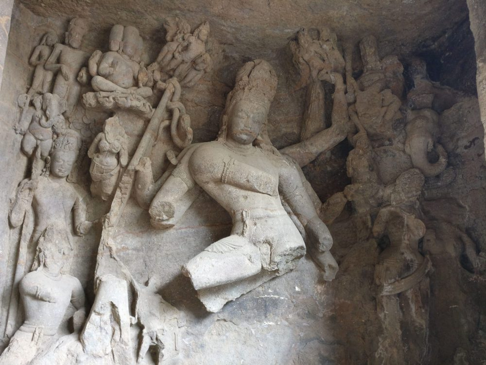 This is from one of the side niches in Cave 1. While the central figure is heavily damaged, notice the detail of the smaller images to the left.