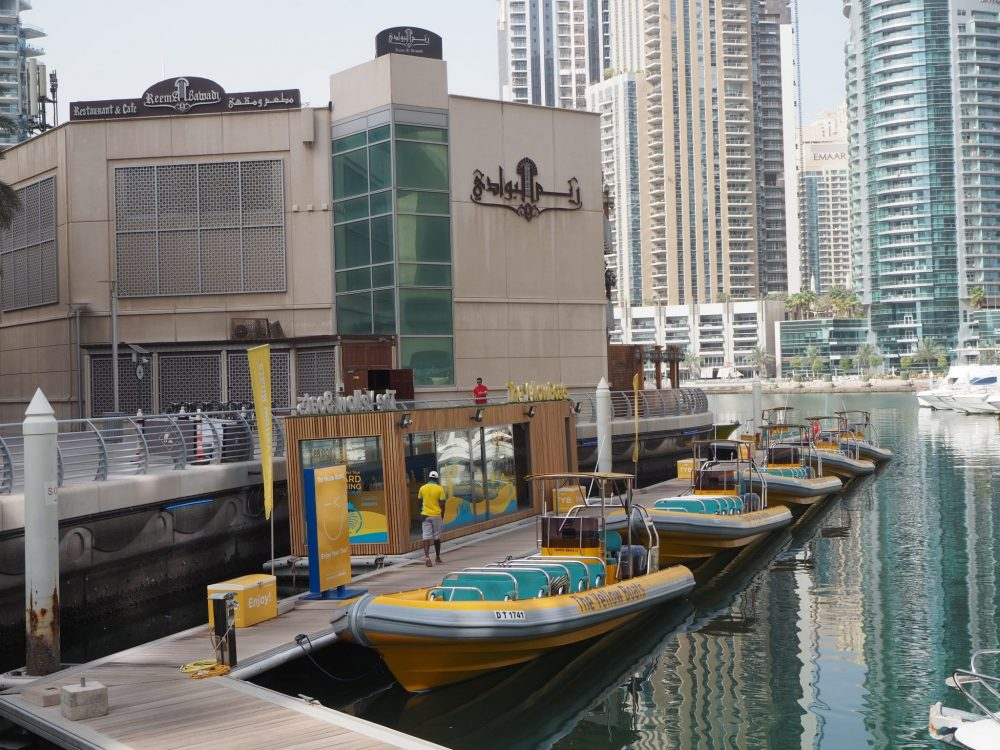 The Yellow Boats awaiting passengers for boat tours in Dubai