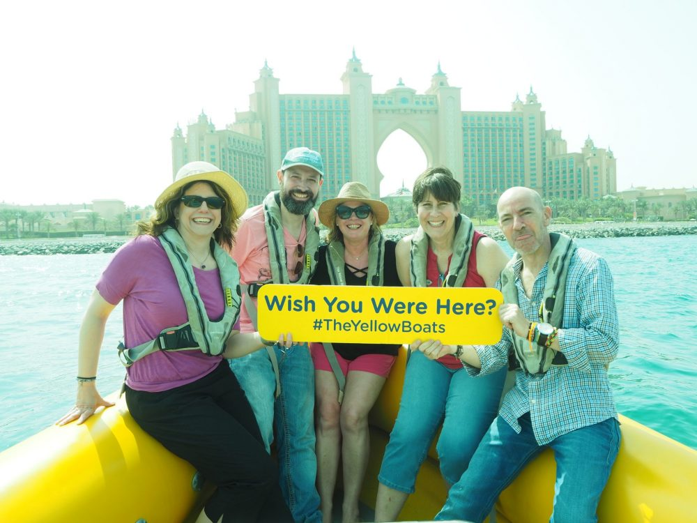 "My friends and I at one of our photo stops, in front of the Atlantis the Palm Hotel. For the ""room"" over the arch, the ""royal bridge suite,"" 924 square meters, prices start at over 10,000 euros a night."