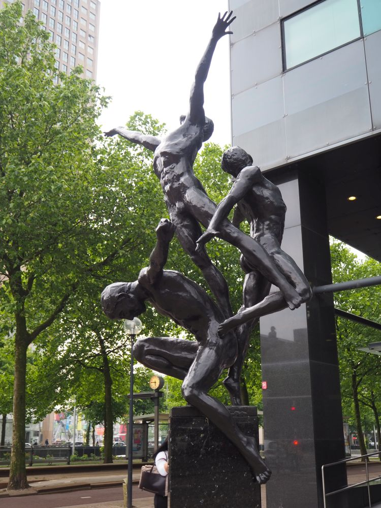 Triumph, by Kees Verkade, shows three naked figures in graceful poses, like gymnasts.