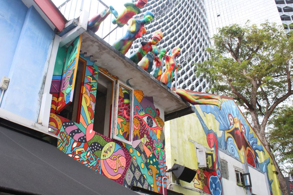 This photo shows only two examples or street art out of the many pieces in the Kampong Glam area. Photo courtesy of Albert Smith.