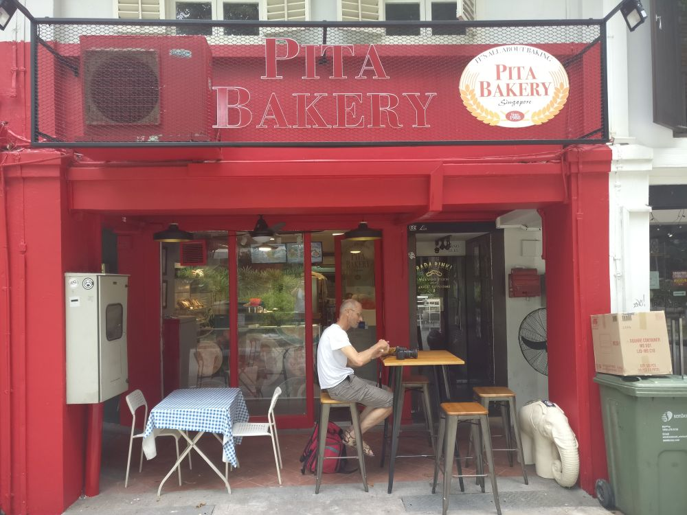 The Pita Bakery with my husband posing outside. All of the restaurants and storefronts we visited via Bitemojo app in Singapore were small-scale businesses like this one.