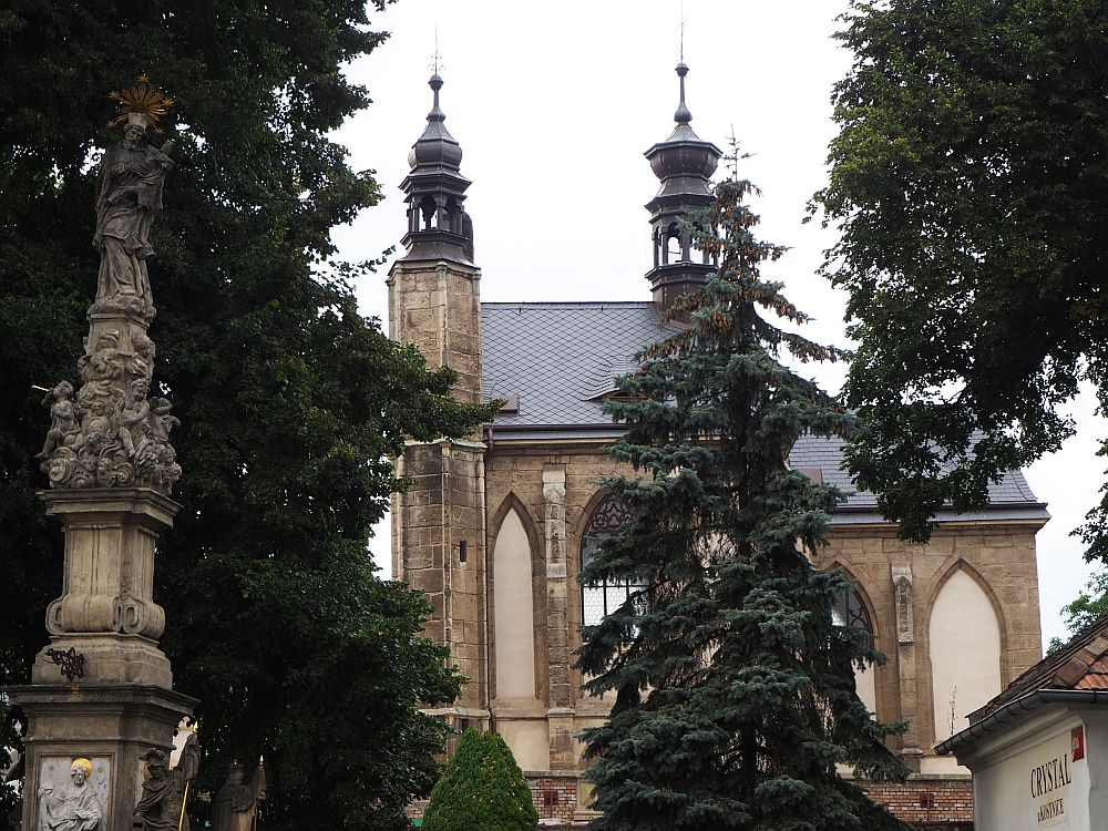 A view of the Bone Church through the trees.