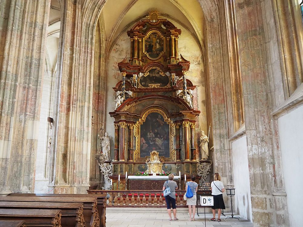 A massive Baroque piece in the side aisle of St. Barbara's Cathedral, part of the Kutna Hora UNESCO designation.