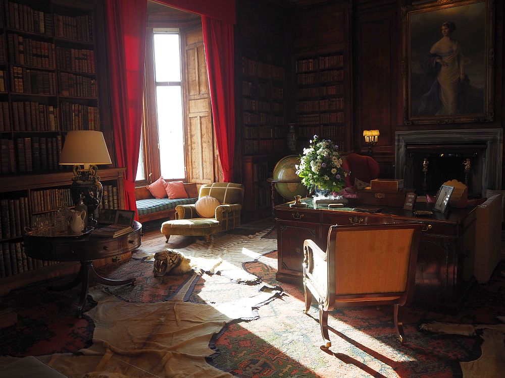 Except for the safari animal pelts on the floor, the library at Dunrobin Castle seemed a pleasant place to read.