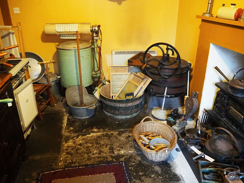 Lots of tools and machines for doing laundry. No kitchen would have had all of them at the same time!