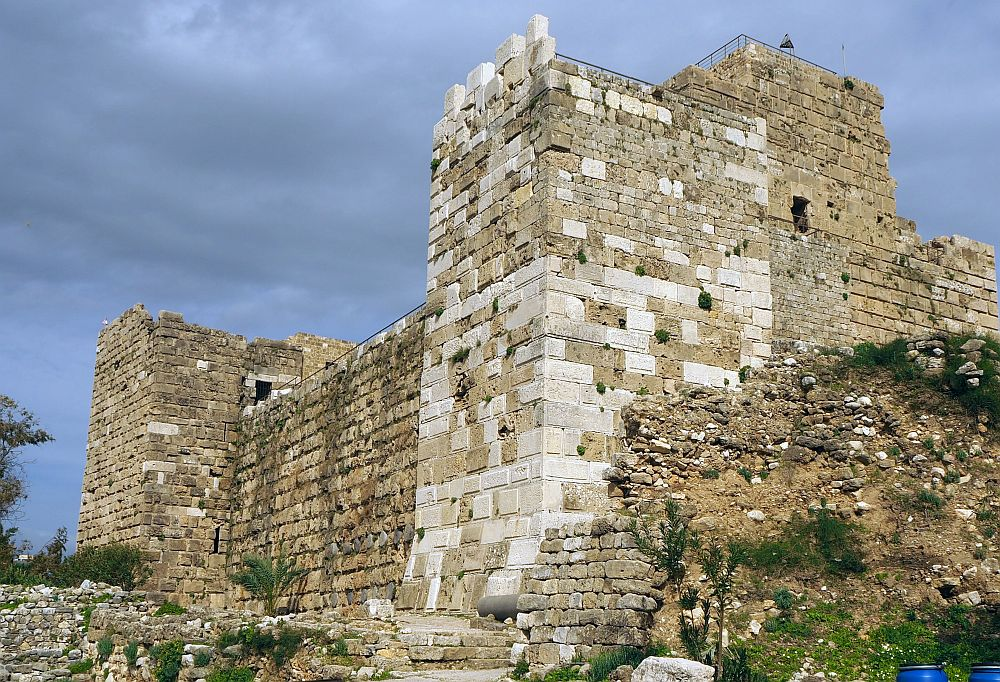 Byblos castle is made of solid walls of large blocks of stone with no windows.
