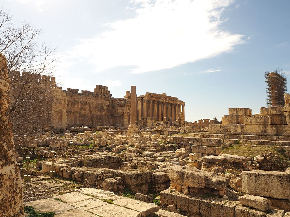 Most of this view is rubble: bits and pieces from what used to be the Temple of Jupiter. An altar is visible in the background with a row of columns. Great Court in Baalbek Ruins, Lebanon.