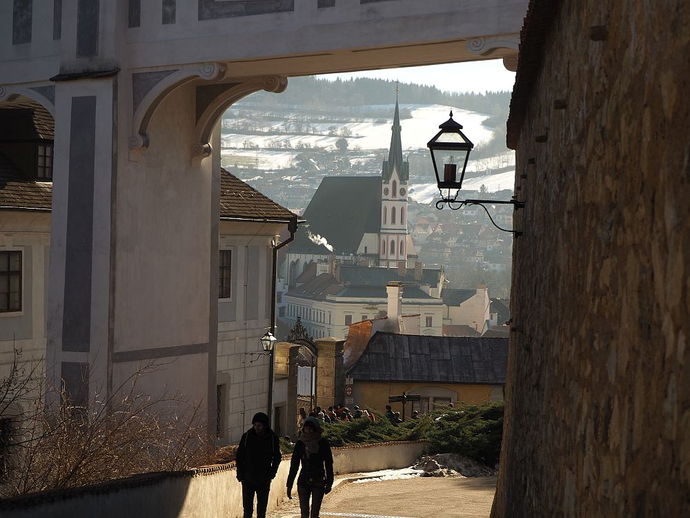 Under the bridges archway, the town is visible in the distance.