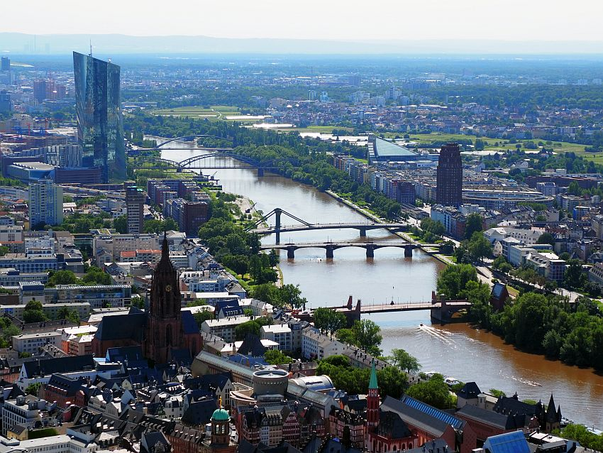 In this view over the city, the river runs diagonally from bottom right to top left. Top left is the tall European Central Bank building, a parallelogram rather than a rectangle. The Cathedral also stands above the buildings around it in the middle distance.