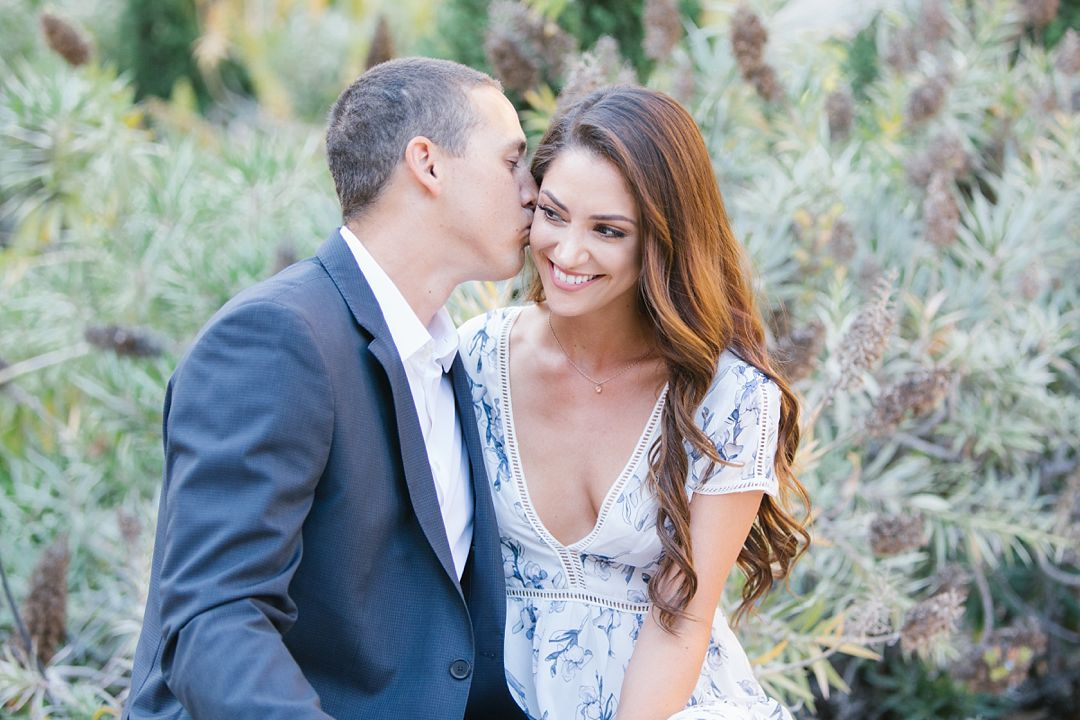 guy kisses girl on cheek during UCLA engagement session
