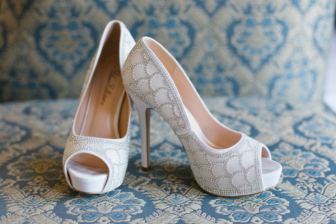 beaded high-heel bridal shoes on damask background