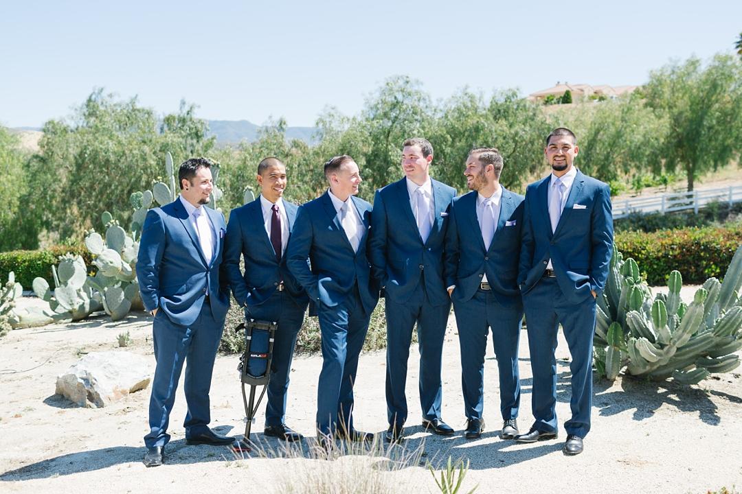 groom and groomsmen looking sharp in blue suits in temecula