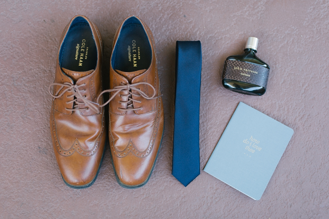 detail of groom's brown leather shoes and blue tie