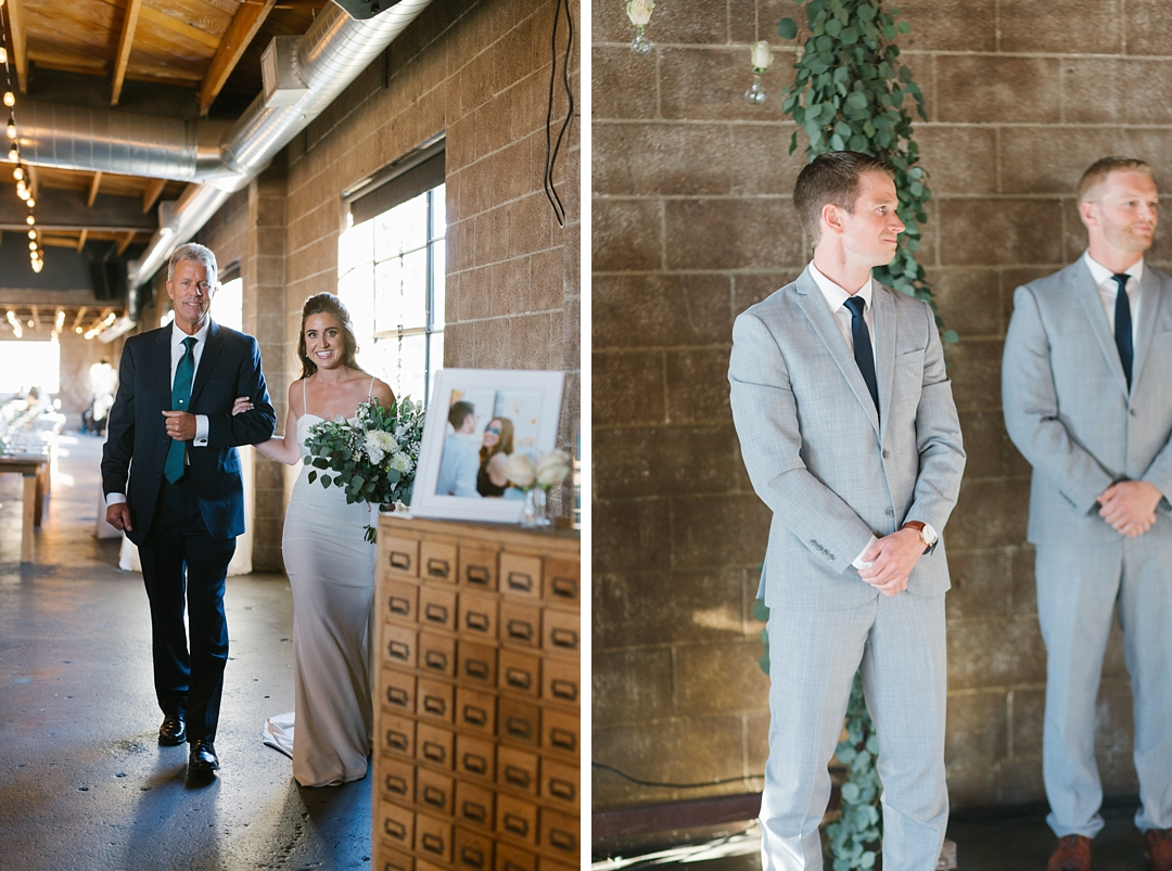 bride walks down aisle at smoky hollow studios while groom looks on