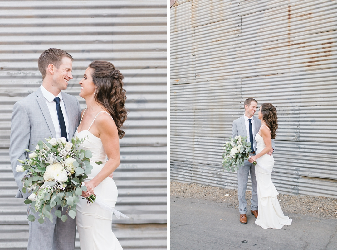 bride and groom against urban looking wall in el segundo wedding